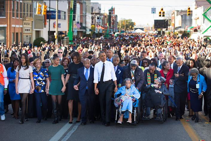 Barack Obama, Amelia Boynton, right, Rep. John Lewis and the President's family lead a march toward the Edmund Pettus Bridge in Selma, Ala., on March 7, 2015, 50 years after