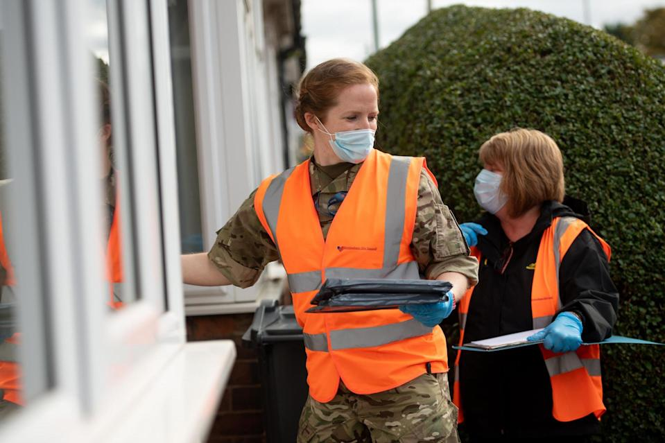 RAF personnel in Selly Oak, close to the University of Birmingham, assisting with Birmingham City Council's 'Drop and Collect' coronavirus test distribution on Tuesday: PA