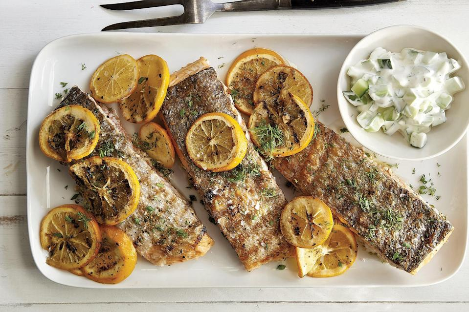"My family really loves both meat and poultry, but I do serve them fish occasionally as a healthy alternative, and this is one of our favorites. This method is easy and foolproof and it brings out the savory sweetness of salmon. You can use regular lemons here, but if you can find Meyer lemons when they're in season (usually from winter into early spring) it's definitely worth it to pick up a few. Generally smaller and more deeply colored than regular lemons, Meyer lemons' juice is more sweet than acidic, like a cross between a lemon and an orange. Even their zest is distinct—flowery more than citrusy—and they work so perfectly here. <a href=""https://www.epicurious.com/recipes/food/views/grilled-salmon-with-meyer-lemons-and-creamy-cucumber-salad?mbid=synd_yahoo_rss"" rel=""nofollow noopener"" target=""_blank"" data-ylk=""slk:See recipe."" class=""link rapid-noclick-resp"">See recipe.</a>"