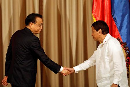 Chinese Premier Li Keqiang shakes hands with President Rodrigo Duterte at Malacanang Palace in metro Manila, Philippines November 15, 2017. REUTERS/Dondi Tawatao