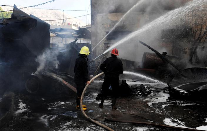 In this photo released by the Syrian official news agency SANA, firefighters extinguish fire at the scene after a bomb attached to a fuel truck exploded outside a Damascus hotel where U.N. observers are staying according to the Syria's state TV in Damascus, Syria, on Wednesday Aug. 15, 2012. According to an Associated Press reporter at the scene, the blast had gone off inside a different parking lot, one belonging to a military compound and not the military command. The lot is near the Dama Rose Hotel, popular with the U.N. observers in Syria. (AP Photo/SANA)