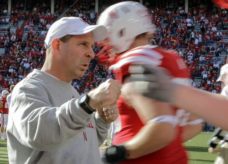 Nebraska head coach Bo Pelini bumps fists with his players prior to an NCAA college football game against Penn State in Lincoln, Neb., Saturday, Nov. 10, 2012. (AP Photo/Nati Harnik)