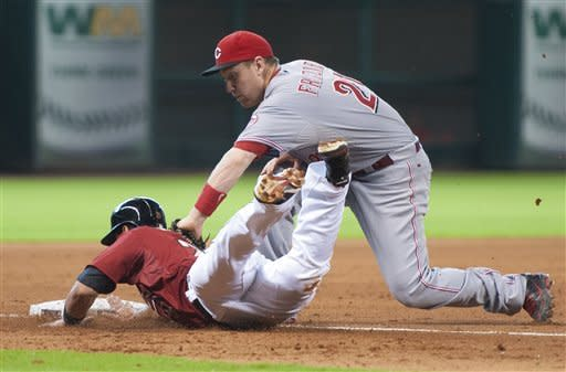 Cincinnati Reds third baseman Todd Frazier, right, tags out Houston Astros' Fernando Martinez on a pickoff throw from catcher Ryan Hanigan during the seventh inning of a baseball game on Sunday, Sept. 2, 2012, in Houston. (AP Photo/Dave Einsel)