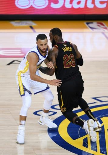Stephen Curry (L), who led the Warriors with 29 points in the opener, says his team will be more aggressive in keeping LeBron James (R) from comfortable situations