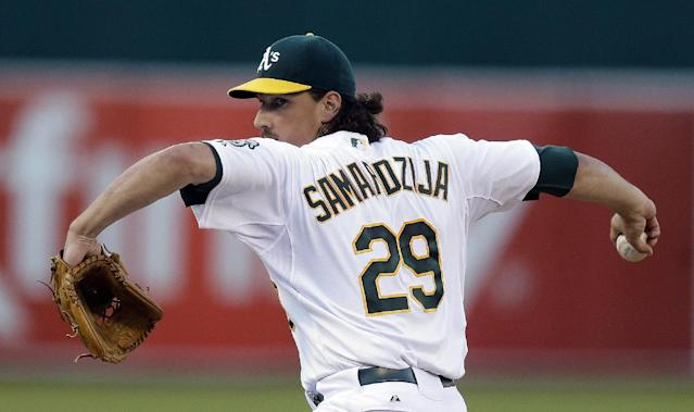 Oakland Athletics' Jeff Samardzija works against the Baltimore Orioles in the first inning of a baseball game Friday, July 18, 2014, in Oakland, Calif. (AP Photo/Ben Margot)