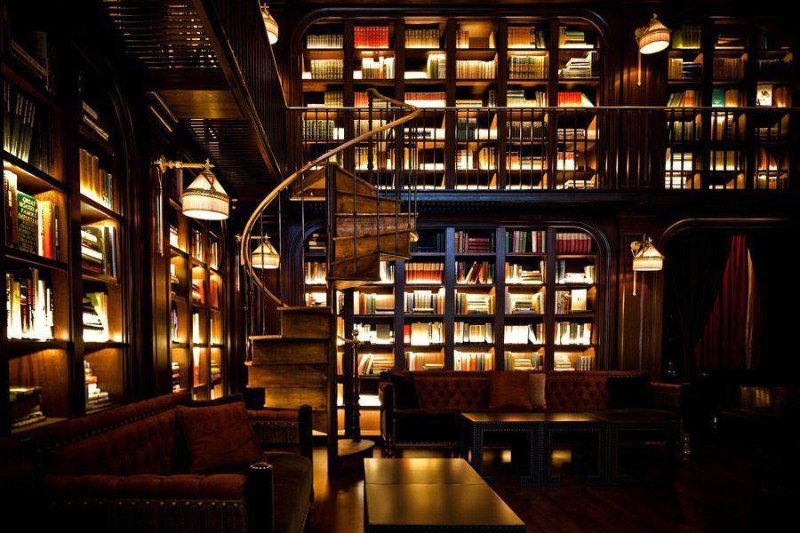 """<p><em>New York, NY</em></p><p>Located inside <a href=""""https://www.thenomadhotel.com/new-york/dining/spaces/library"""" rel=""""nofollow noopener"""" target=""""_blank"""" data-ylk=""""slk:The NoMad Hotel in NYC"""" class=""""link rapid-noclick-resp"""">The NoMad Hotel in NYC</a>, guests and visitors can enjoy a specialty cocktail in the comfort of an elegant, two-story library. The space features an extensive collection of books and is connected with a spiral staircase, imported from the South of France.<br></p><p>Photo: Facebook/<a href=""""https://www.facebook.com/TheNoMadHotelNYC/photos/a.1052099471538606/1052098691538684/?type=3&theater"""" rel=""""nofollow noopener"""" target=""""_blank"""" data-ylk=""""slk:The Nomad Hotel NYC - Benoit Linero"""" class=""""link rapid-noclick-resp"""">The Nomad Hotel NYC - Benoit Linero</a></p>"""