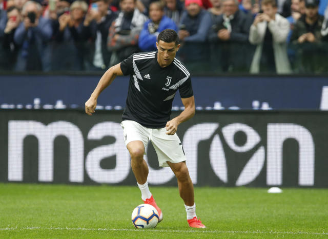 Juventus forward Cristiano Ronaldo warms up prior to the Serie A soccer match between Udinese and Juventus, at the Dacia Arena stadium in Udine, Italy, Saturday, Oct.6, 2018. (AP Photo/Antonio Calanni)