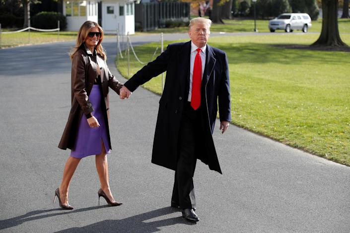 President Trump and first lady Melania Trump leave the White House to travel to the G-20 summit in Argentina Thursday. (Photo: Jim Young/Reuters)