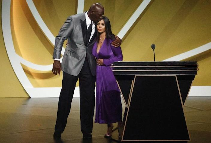 Hall of Famer Michael Jordan gives Vanessa Bryant a kiss on the head after her speech at the Hall of Fame induction.