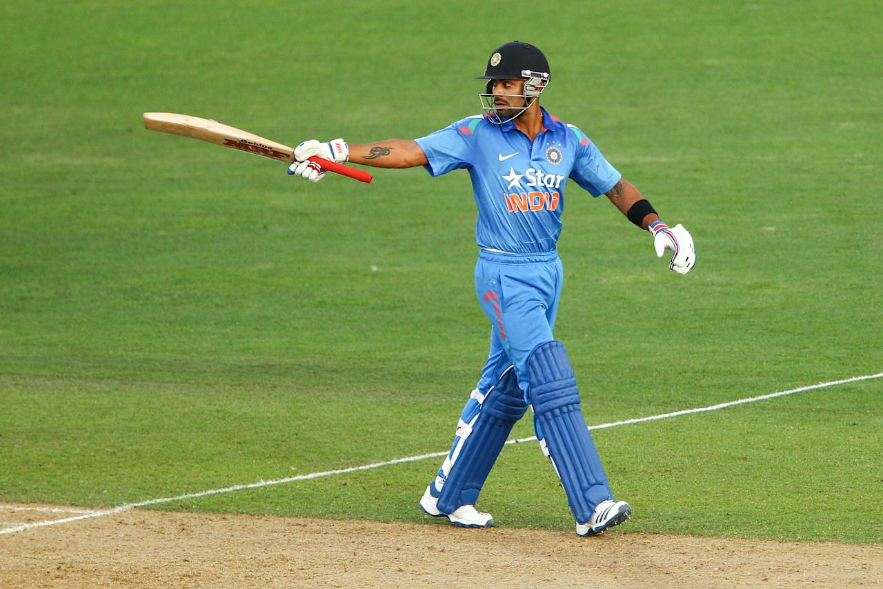 NAPIER, NEW ZEALAND - JANUARY 19:  Virat Kohli of India celebrates his half century during the first One Day International match between New Zealand and India at McLean Park on January 19, 2014 in Napier, New Zealand.  (Photo by Hagen Hopkins/Getty Images)