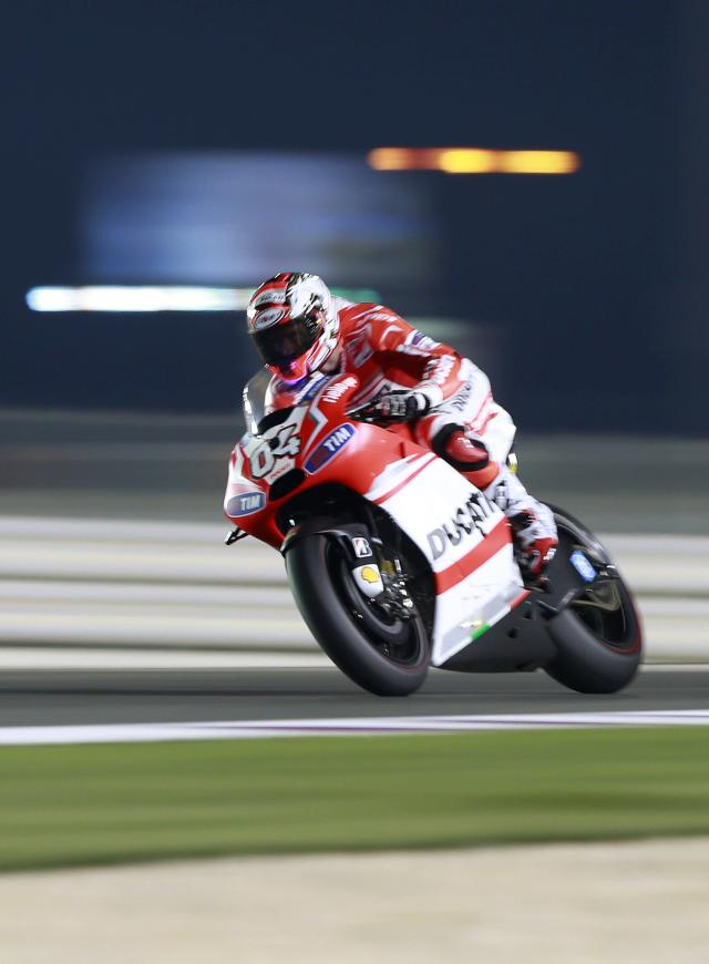 Ducati Team MotoGP rider Andrea Dovizioso of Italy rides his bike during a free practice session at the MotoGP World Championship at the Losail International circuit in Doha March 21, 2014. REUTERS/Mohammed Dabbous (QATAR - Tags: SPORT MOTORSPORT)