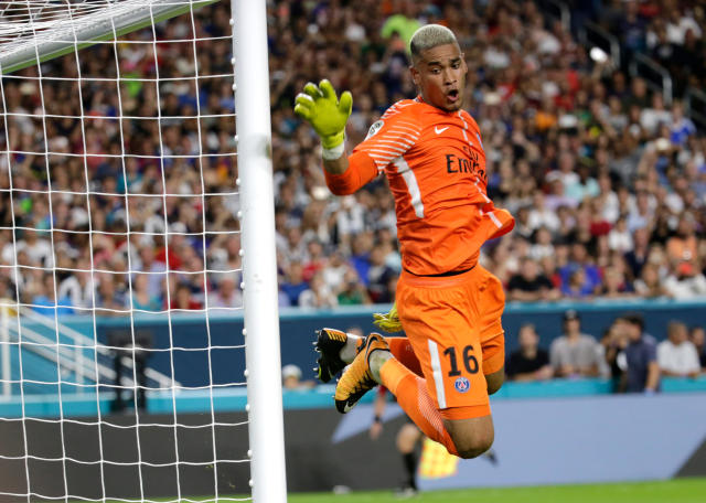 FILE - In this Wednesday, July 26, 2017 file photo, Paris Saint-Germain goalkeeper Alphonse Areola defends during the first half of an International Champions Cup soccer match against Juventus, in Miami Gardens, Fla. The next four games could be crucial in deciding whether PSG keeps Areola or moves for a big-name goalie in the summer transfer window, having been linked with Belgium No. 1 Thibaut Courtois. (AP Photo/Lynne Sladky, File)