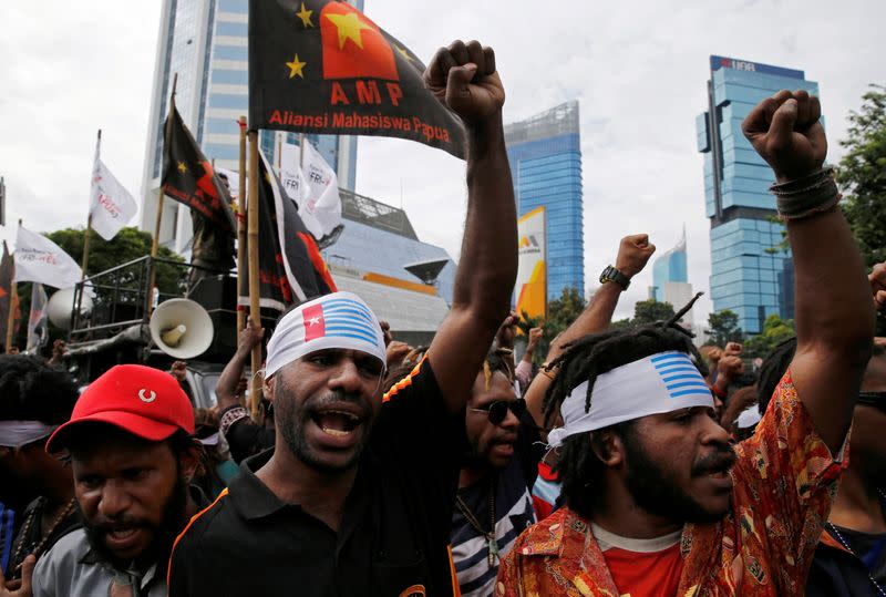 FILE PHOTO: Protesters shout slogans during a rally calling for their right to self-determination in the Indonesian controlled part of Papua, in Jakarta, Indonesia