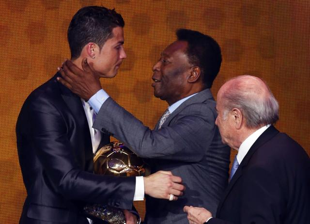 Portugal's Cristiano Ronaldo is congratulated by Pele as FIFA President Sepp Blatter (R) looks on after being awarded the FIFA Ballon d'Or 2013 in Zurich January 13, 2014. Portugal and Real Madrid forward Cristiano Ronaldo was named the world's best footballer for the second time on Monday, preventing his great rival Lionel Messi from winning the award for a fifth year in a row. REUTERS/Arnd Wiegmann (SWITZERLAND - Tags: SPORT SOCCER)