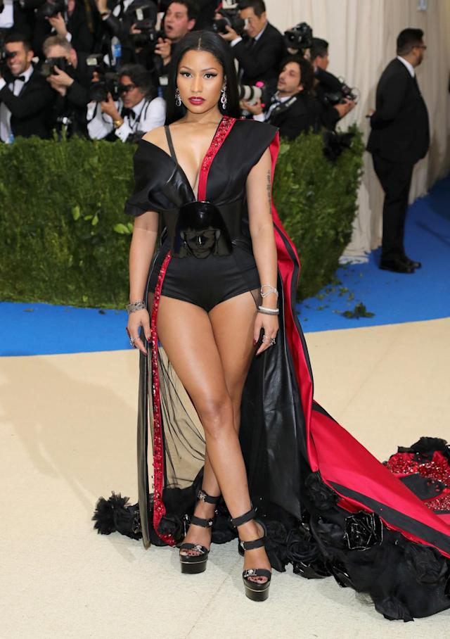 <p>The singer wore a black bodysuit and red cape ensemble with a unique belt featuring Rei Kawakubo's face. (Photo by Neilson Barnard/Getty Images) </p>
