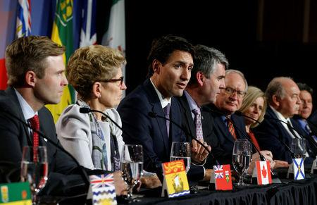 Canada's Prime Minister Justin Trudeau (3rd L) speaks during the closing news conference at the First Ministers' meeting in Ottawa, Ontario, Canada, December 9, 2016. REUTERS/Chris Wattie