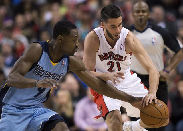 Toronto Raptors guard Greivis Vasquez (21) battles for the loose ball against Memphis Grizzlies guard Tony Allen, left, during first half NBA basketball action in Toronto on Friday, March. 14, 2014. (AP Photo/The Canadian Press, Nathan Denette)