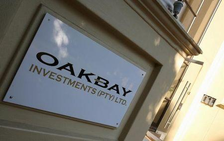 A logo of Oakbay Investments is seen at the entrance of their offices in Sandton, outside Johannesburg, South Africa April 13, 2016. REUTERS/Siphiwe Sibeko/File Photo