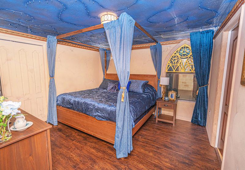PIC BY @LOMA HOMES / CATERS NEWS AGENCY (PICTURED- A Bedroom with a four-poster-bed ) - Harry Potter fans looking for a first post-lockdown trip can put this place at the top of their list - a night in a Hogwarts- themed Airbnb. The eight-bedroom home, called ' Wizard's Way' is based in Florida, US, near the Universal Orlando Resort. There are rooms based on the four houses Gryffindor, Hufflepuff, Ravenclaw, and Slytherin and each bathroom has its own Harry Potter theme, from Hedwig and the Ministry of Magic to Dobby, and Sirius Black. One of the bedrooms features an interactive car-shaped bed which is inspired by the scene where Harry and Ron get stuck in the Willow Tree of the second part of the film series. - SEE CATERS COPY