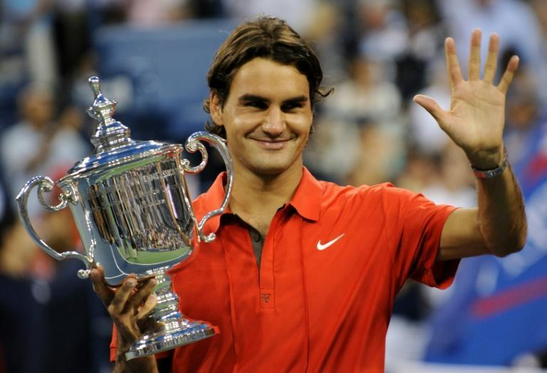 That's five: Roger Federer celebrates victory over Andy Murray in the 2008 US Open final