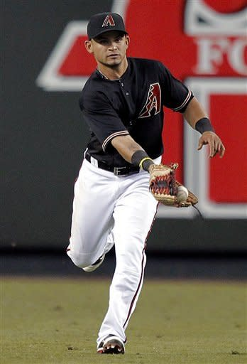 Arizona Diamondbacks' Gerardo Parra can't hold on to a base hit by Milwaukee Brewers' Edwin Maysonet during the second inning of a baseball game, Saturday, May 26, 2012, in Phoenix. (AP Photo/Matt York)