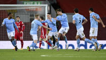 Manchester City's Phil Foden, center, celebrates after scoring his side's fourth goal during the English Premier League soccer match between Liverpool and Manchester City at Anfield Stadium, Liverpool, England, Sunday, Feb. 7, 2021. (Laurence Griffiths/Pool via AP)