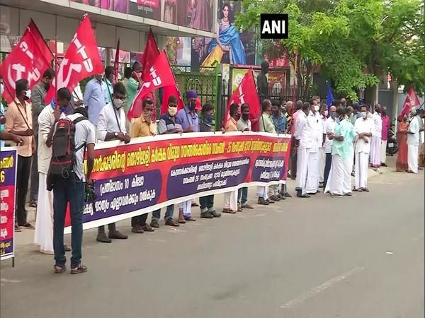 Centre of Indian Trade Unions (CITU) workers formed a human chain in Kochi as part of the protest against the Centre's labour laws. (Photo/ANI)