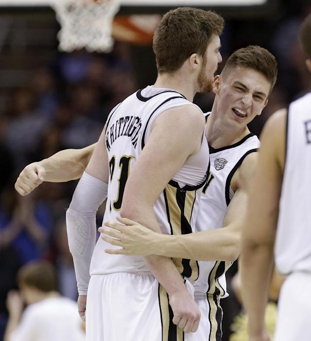 Western Michigan's Mario Matasovic, right, congratulates Shayne Whittington after Western Michigan defeated Akron 64-60 in an NCAA college basketball game at the Mid-American Conference tournament Friday, March 14, 2014, in Cleveland. (AP Photo/Tony Dejak)