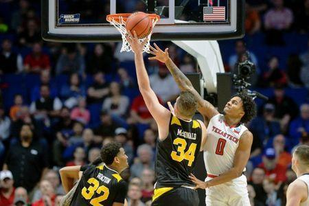 Mar 22, 2019; Tulsa, OK, USA; Texas Tech Red Raiders guard Kyler Edwards (0) attempts to block the shot of Northern Kentucky Norse forward Drew McDonald (34) during the second half in the first round of the 2019 NCAA Tournament at BOK Center. The Texas Tech Red Raiders won 72-57. Mandatory Credit: Brett Rojo-USA TODAY Sports