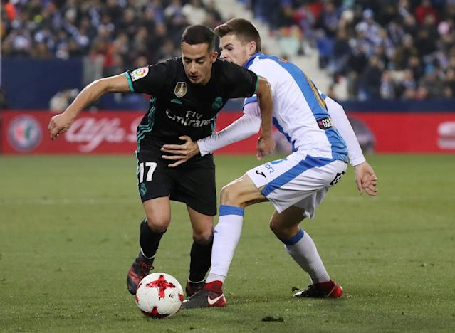 Soccer Football - Spanish King's Cup - Leganes vs Real Madrid - Quarter-Final - First Leg - Butarque Municipal Stadium, Leganes, Spain - January 18, 2018 Real Madrid's Lucas Vazquez in action with Leganes' Gerard Gumbau REUTERS/Susana Vera