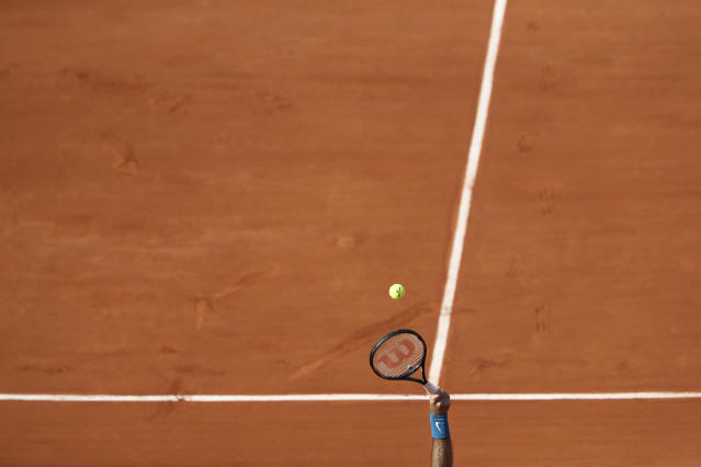 Argentina's Juan Martin del Potro serves against France's Julien Benneteau during their second round match of the French Open tennis tournament at the Roland Garros stadium in Paris, France, Thursday, May 31, 2018. (AP Photo/Thibault Camus)