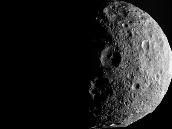The shadowy outlines of the terrain in Vesta's northern region are visible in this image from NASA's Dawn spacecraft. The image comes from the last sequence of images Dawn obtained of the giant asteroid Vesta as it departed the giant asteroid S