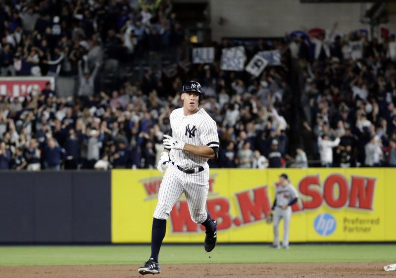 Aaron Judge rounds the bases are his homer in the AL wild-card game Tuesday night at Yankee Stadium. (AP)