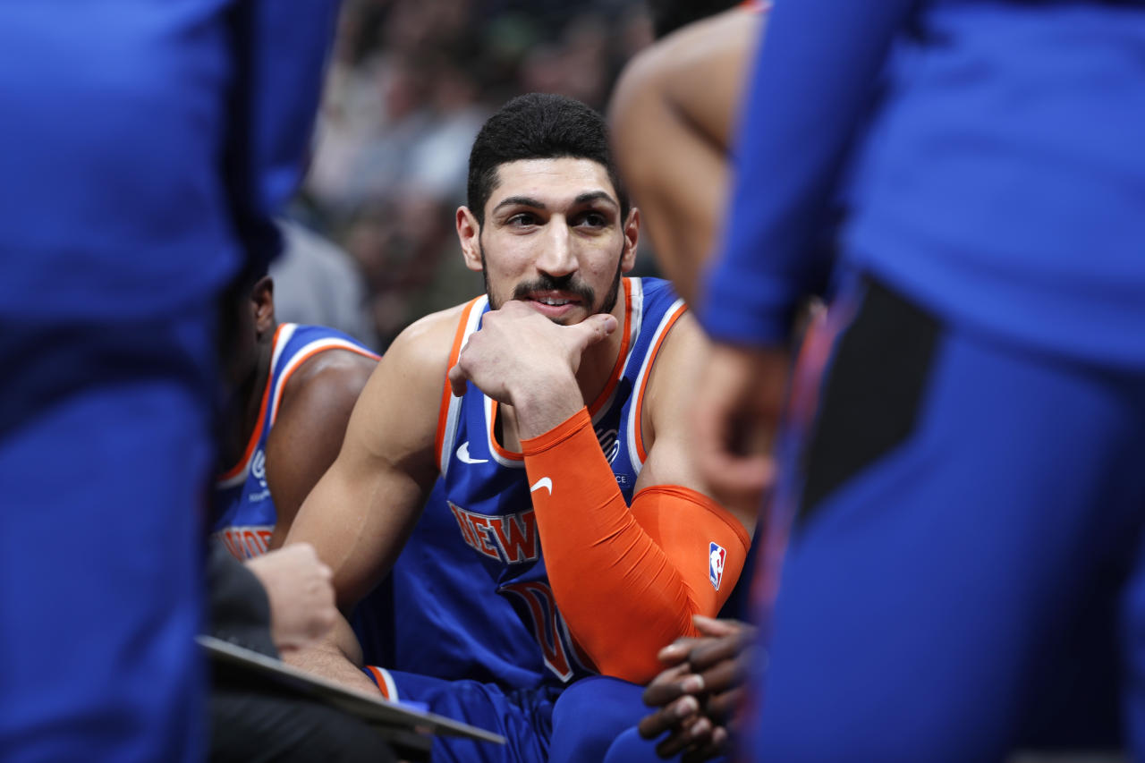 "FILE - In this Jan. 1, 2019, file photo, New York Knicks centre Enes Kanter, of Turkey, jokes with teammates during a timeout the first half of the team's NBA basketball game against the Denver Nuggets, in Denver. Turkish media reports said Wednesday, Jan. 16, 2019, that Turkish prosecutors are seeking an international arrest warrant and had prepared an extradition request for Kanter, accusing him of membership in a terror organisation. Sabah newspaper said prosecutors were seeking an Interpol ""Red Notice"" citing Kanter's ties to Fethullah Gulen, who Turkey blames for a failed 2016 coup, and accusing him of providing financial support to his group. (AP Photo/David Zalubowski, File)"