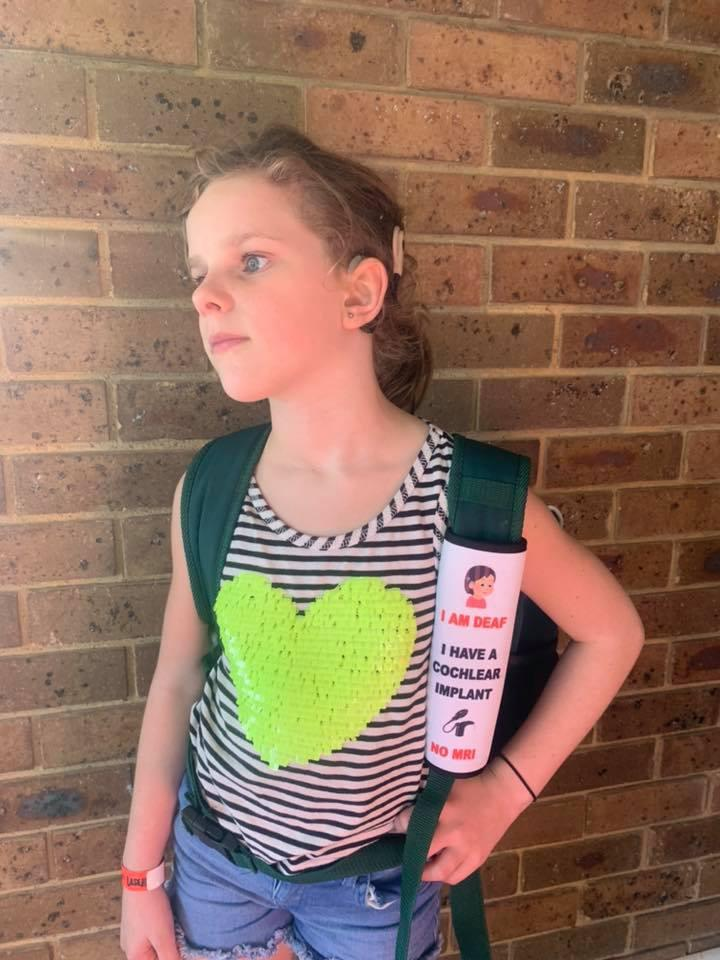 Shae models the velcro cover made by her mum. Source: Facebook / Personalised by Nat
