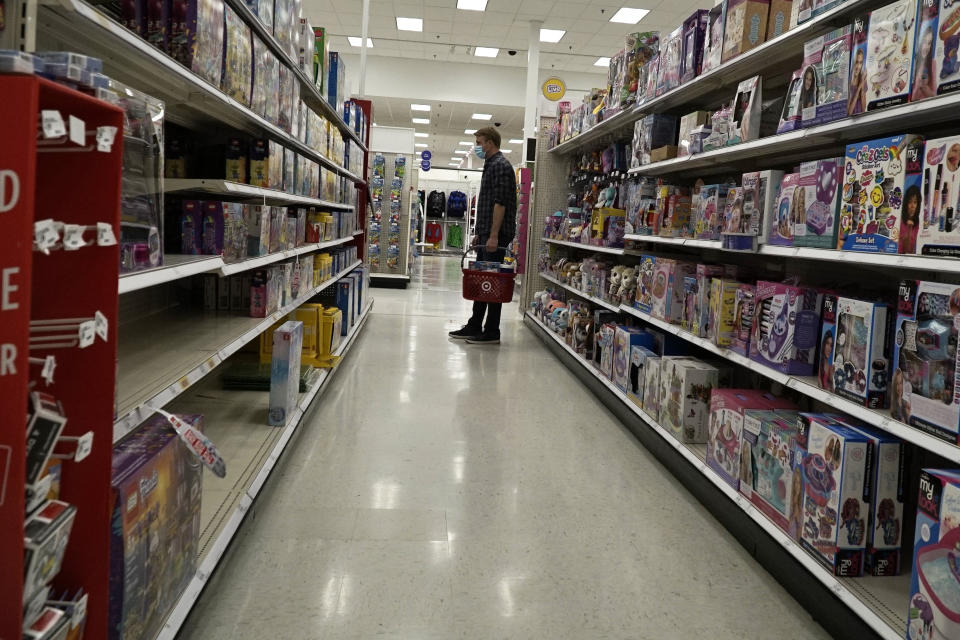 A man wears mask as he shops for  toys at a Target store during the COVID-19 pandemic in Schaumburg, Ill., Wednesday, May 6, 2020. (AP Photo/Nam Y. Huh)
