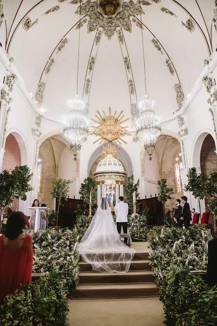 """The religious ceremony with our witnesses—our two sisters and our two cousins—by our side. The priest ended by saying, as the Beatles famously said, """"All you need is love""""!"""