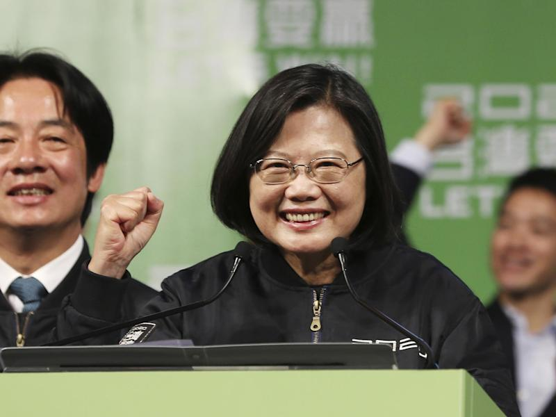 Tsai Ing-wen celebrates her re-election with supporters at a rally: AP