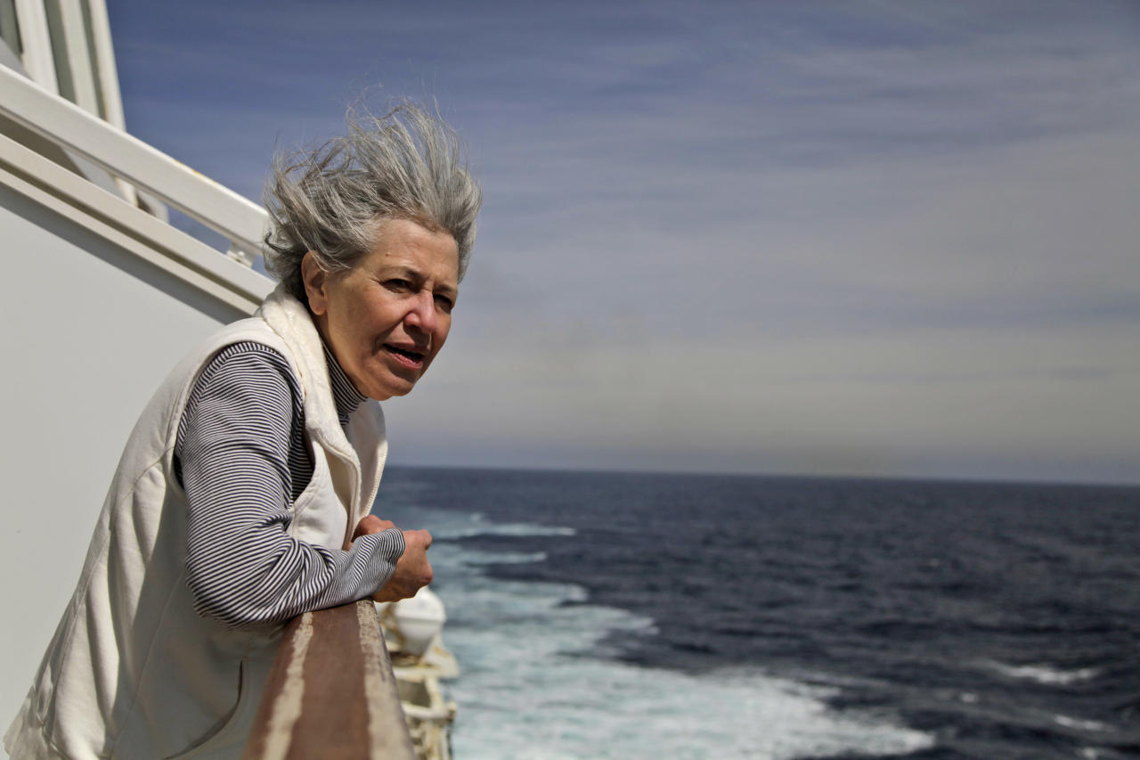 Helen Edwards, 62, from Silver Spring, Md., reflects as the MS Balmoral Titanic memorial cruise ship approaches the wreck site of the Titanic in the Atlantic Ocean, Saturday, April 14, 2012. A century after the great ship went down with the loss of 1,500 lives, events around the globe are marking a tragedy that retains a titanic grip on the world's imagination - an icon of Edwardian luxury that became, in a few dark hours 100 years ago, an enduring emblem of tragedy. (AP Photo/Lefteris Pitarakis)