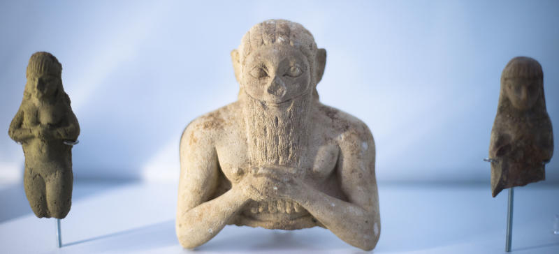 """The upper part of a male foundation figure, 3000 - 2400 BC is displayed at the exhibition """"Uruk 5,000 Years of the Megacity"""" at the Pergamon Museum Berlin, Wednesday, April 24, 2013. Berlin's Pergamon Museum is offering visitors a glimpse of perhaps the world's first real metropolis in a new exhibition that traces the long history of Uruk, in present-day Iraq. The show marks a century of excavations at Uruk. But even now, organizers say that only about 4.5 percent of the sprawling site in the Iraqi desert has been explored. (AP Photo/Markus Schreiber)"""