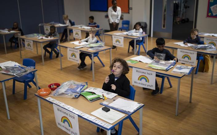 Children sit at individual desks during a lesson at the Harris Academy's Shortland's school on June 04, 2020 in London, England. - Dan Kitwood/Getty Images Europe