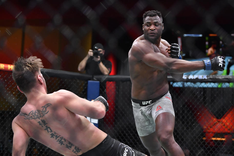 LAS VEGAS, NEVADA - MARCH 27: (R-L) Francis Ngannou of Cameroon drops Stipe Miocic in their UFC heavyweight championship fight during the UFC 260 event at UFC APEX on March 27, 2021 in Las Vegas, Nevada. (Photo by Chris Unger/Zuffa LLC)