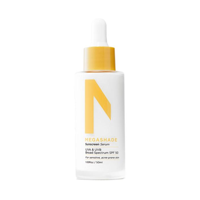 """""""My skin is glowier, clearer, and better <a href=""""https://www.allure.com/gallery/best-sunscreens-for-summer?mbid=synd_yahoo_rss"""" rel=""""nofollow noopener"""" target=""""_blank"""" data-ylk=""""slk:protected from the sun"""" class=""""link rapid-noclick-resp"""">protected from the sun</a> than ever with this lightweight, milky formula packed with SPF 50. The ZitSticka Megashade Breakout-Proof SPF Serum combines the powers of chemical and mineral UV blockers while banishing breakouts with <a href=""""https://www.allure.com/story/what-is-niacinamide-skin-care-benefits?mbid=synd_yahoo_rss"""" rel=""""nofollow noopener"""" target=""""_blank"""" data-ylk=""""slk:niacinamide"""" class=""""link rapid-noclick-resp"""">niacinamide</a> and <a href=""""https://www.allure.com/story/essential-oils-guide?mbid=synd_yahoo_rss"""" rel=""""nofollow noopener"""" target=""""_blank"""" data-ylk=""""slk:tea tree extract"""" class=""""link rapid-noclick-resp"""">tea tree extract</a>. It rubs in seamlessly and transparently. To reapply throughout the day, I dab it on with the <a href=""""https://shop-links.co/1746940172037293846"""" rel=""""nofollow noopener"""" target=""""_blank"""" data-ylk=""""slk:Merit Brush No. 1"""" class=""""link rapid-noclick-resp"""">Merit Brush No. 1</a>."""" <em>— Devon Abelman, beauty editor</em>"""