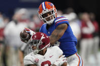 Florida wide receiver Trevon Grimes (8) makes a touchdown catch for a touchdown against Alabama defensive back Patrick Surtain II (2) during the second half of the Southeastern Conference championship NCAA college football game, Saturday, Dec. 19, 2020, in Atlanta. (AP Photo/John Bazemore)