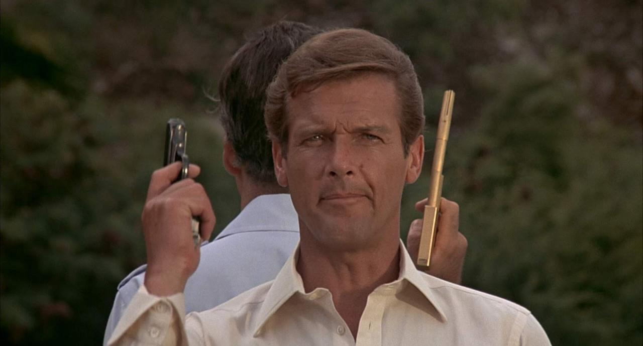 """<p>It was on this entry that the more bawdy, tongue-in-cheek tone of the Moore era really came into play. This is perhaps most apparent when Bond dons a fake third nipple in order to pass himself off as Christopher Lee's Scaramanga. Of this, Bond remarks, """"he must have found me quite titilating."""" (Picture Credit: MGM-UA) </p>"""