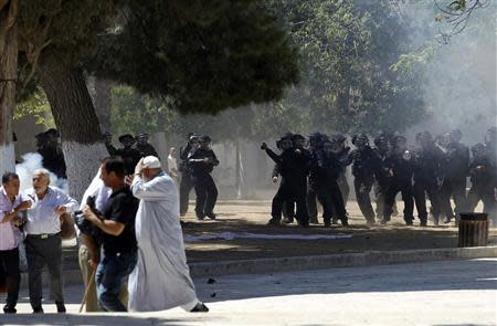 Israeli policemen react during clashes with Palestinians on the compound known to Muslims as the Noble Sanctuary and to Jews as the Temple Mount in Jerusalem's Old City September 6, 2013. REUTERS/ Ammar Awad