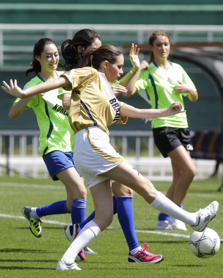 FILE - In this Aug. 29, 2011 file photo, Miss Brazil Priscila Machado kicks the ball during a soccer match in Sao Paulo, Brazil. The Miss Universe pageant will be held in Sao Paulo on Sept. 12. Miss Universe contestants from six continents spent the last three weeks in South America's largest city, trying to learn samba dance steps, visiting impoverished kids and kicking a football around for cameras as the globe's biggest beauty contest is held in Brazil for the first time. The 60th anniversary of the Miss Universe pageant will be broadcast on Sept. 12. Last year's winner was Mexico's Jimena Navarrete. (AP Photo/Andre Penner, File)