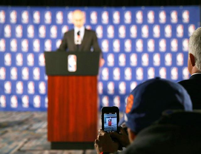 NEW YORK, NY - APRIL 29: Spike Lee takes a cell phone picture during the press conference by NBA Commissioner Adam Silver discusses punishment for Los Angeles Clippers owner Donald Sterling at the Hilton Hotel on April 29, 2014 in New York City. Silver announced that Sterling will be banned from the NBA for life and will be fined $2.5 million for racist comments released in audio recordings. (Photo by Elsa/Getty Images)