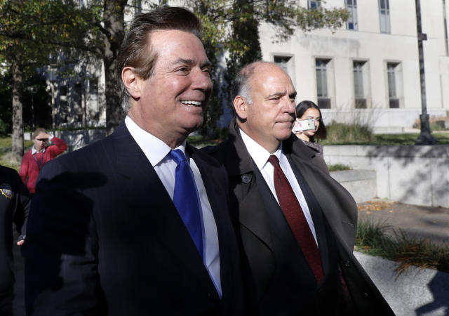 Paul Manafort, left, leaves Federal District Court in Washington on Monday. (Photo: Alex Brandon/AP)