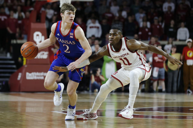 Kansas' Christian Braun (2) is defended by Oklahoma's De'Vion Harmon (11) during the first half of an NCAA college basketball game in Norman, Okla., Tuesday, Jan. 14, 2020. (AP Photo/Garett Fisbeck)